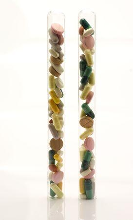 Vertical test tubes full of pills