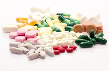 Colorful and multi-shaped pills over wihte background