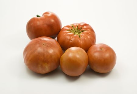 Organic red tomatoes on white background Stock Photo