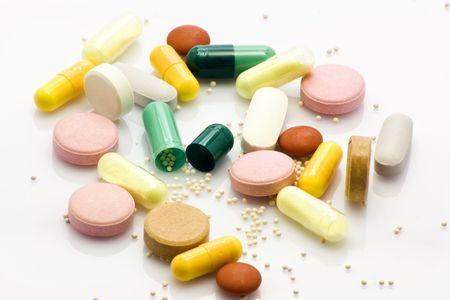 Multiple pills over white background Stock Photo