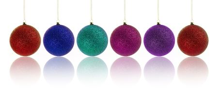 Colorful set of christmas bubbles over white background photo