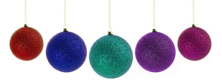 Different sized colorful christmas balls