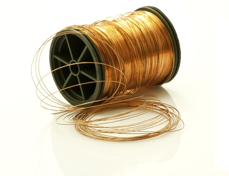 Horizontal copper bobbin on white