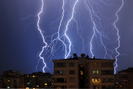 Multiple lightning over bright blue sky in the night