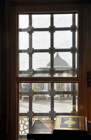 Quran shaded by the sun through window of the mosque Stock Photo