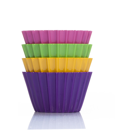 Four colorful cups inside each other Stock Photo