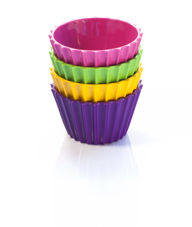 Four colorful cups on white background Stock Photo