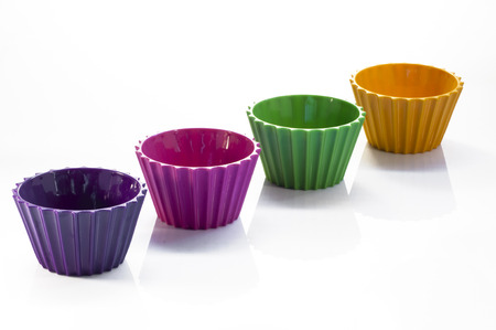Colorful cups over white background Stock Photo