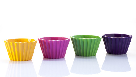 Four colorful cups over white