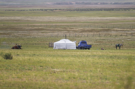 independent mongolia: Yurt in the steppes of Mongolia to the man and horse