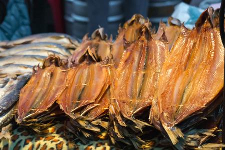 listvyanka: Dried fish Omul lying on the counter in Listvyanka, Lake Baikal Stock Photo