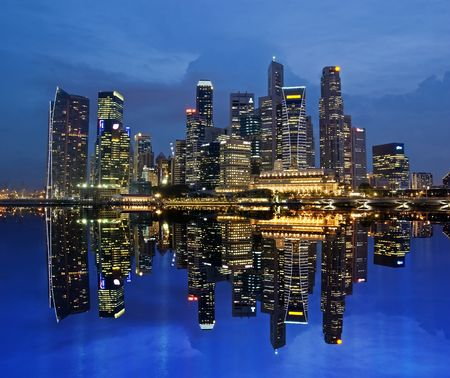 district: Singapore Skyline Reflected on Marina Bay Stock Photo