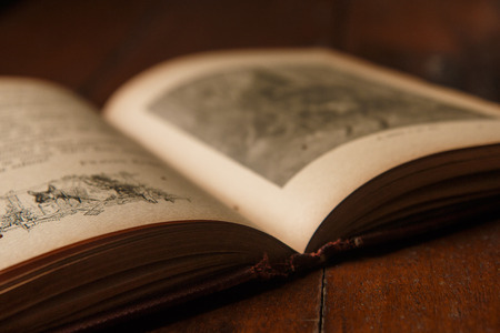 old book of fables with number one written in evidence on the back on rustic wooden table
