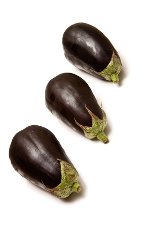 Egg plant or aubergines isolated on a white studio background. photo