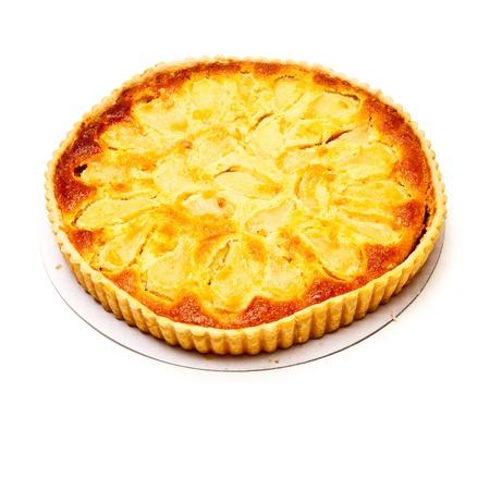 Pear and frangipane tart isolated on a white stuido background.