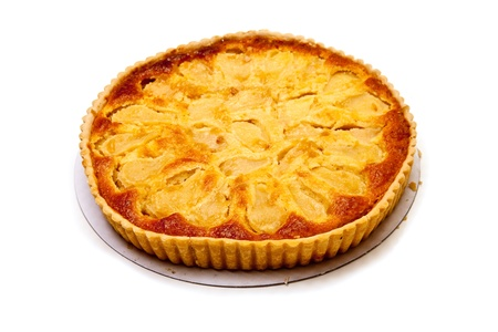 Pear and frangipane tart isolated on a white stuido background. photo