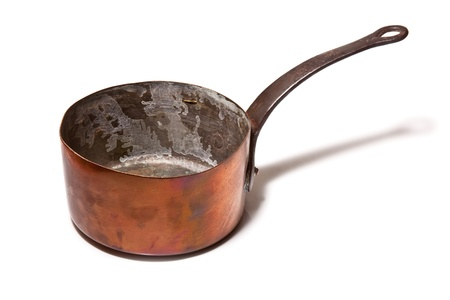 Copper saucepan isolated on a white studio background