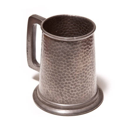 pewter mug: Pewter beer tankard isolated on a white studio background  Stock Photo
