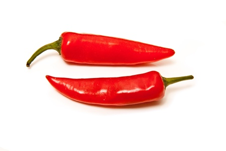 Red chilli peppers isolated on a white studio background. photo