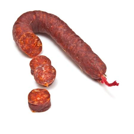 Chorizo De Pueblo sausage isolated on a white studio background.