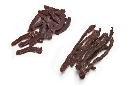 South African biltong strips  isolated on a white background