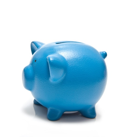 Piggy bank or money box isolated on a white studio background. photo