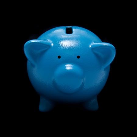 money box: Piggy bank or money box on a black studio background. Stock Photo