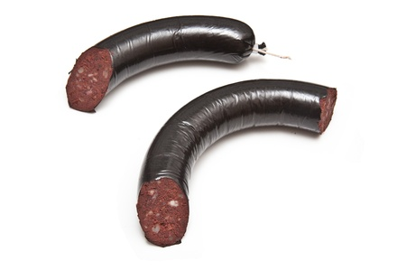 black pudding or blood sausage isolated on a white studio background.