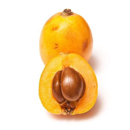 Loquat, or Japanese Medlar fruit isolated on a white studio background.