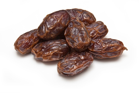 Dried Medjool dates isolated on a white studio background.