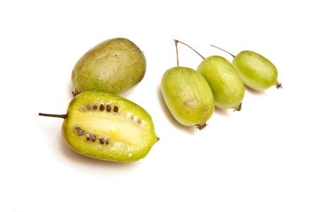 Kiwiberries isolated on a white studio background. Stock Photo