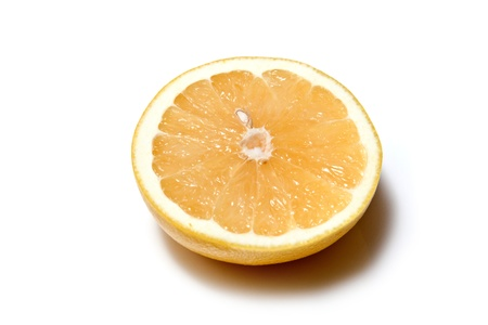 Grapefruit halved on a white studio background