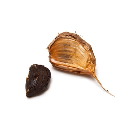 Smoked black garlic isolated on a white studio background.