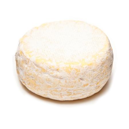 petit: Petit Reblochon cheese isolated on a white studio background. Stock Photo