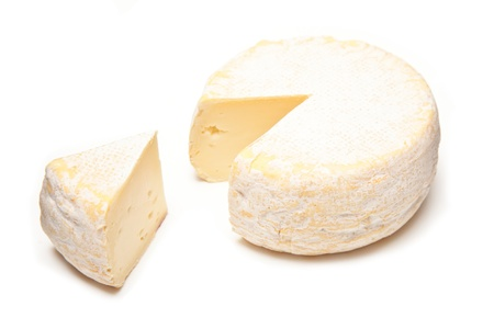 Petit Reblochon cheese isolated on a white studio background. Stock Photo
