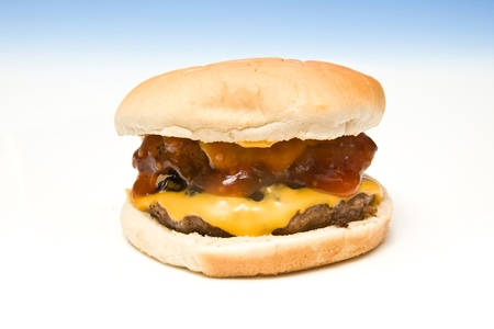 Cheeseburger on a graduated blue studio background. photo