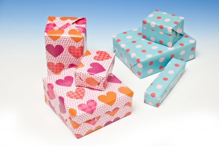 Presents or gifts on a graduated blue studio background. photo