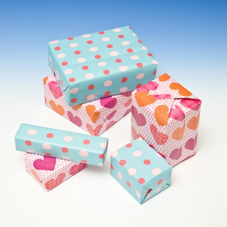 Presents or gift's on a graduated blue studio background. Stock Photo - 16538239