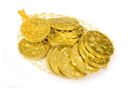 Chocolate money isolated on white studio background. Stock Photo