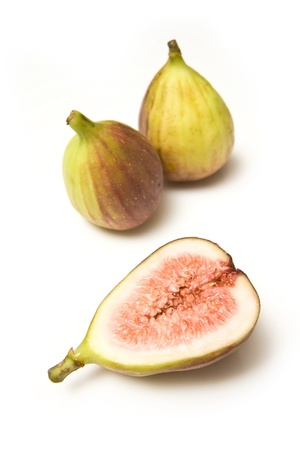 Fresh figs isolated on a white studio background. photo