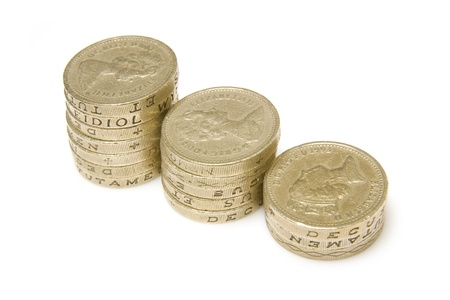 buisness: Pound coins isolated on a white studio background. Stock Photo