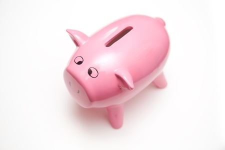 Piggy bank style money box isolated on a white studio background. Stock Photo - 17707501