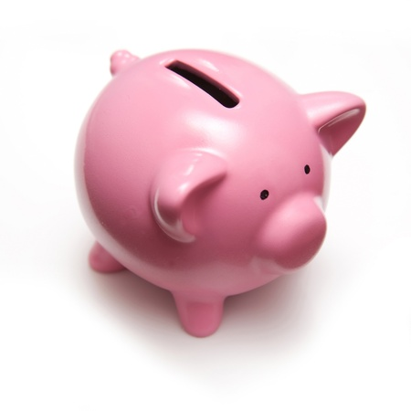 Piggy bank style money box isolated on a white studio background. Stock Photo - 17707421