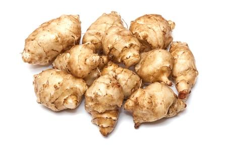 helianthus: Jersalem Artichoke (Helianthus tuberosus) vegetable isolated on a white studio background. Stock Photo