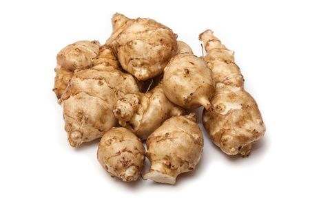Jersalem Artichoke (Helianthus tuberosus) vegetable isolated on a white studio background. Stock Photo