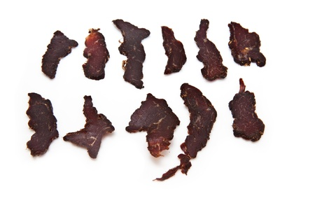 Sliced Biltong  beef jerky  isolated on a white background