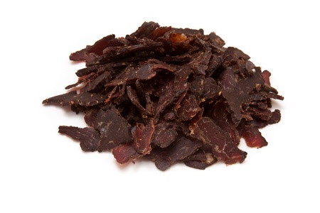 Sliced biltong or beef jerky on a white background