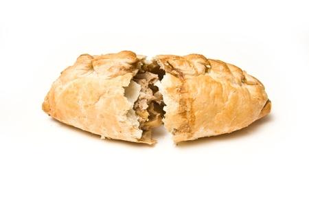 Cornish pasty isolated on a white studio background. Stock Photo