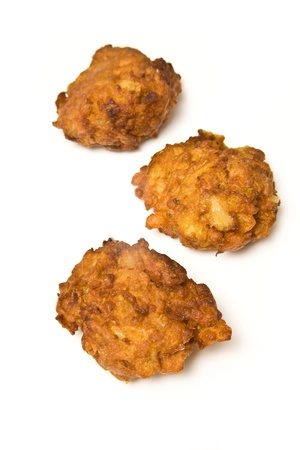 Onion Bhajis isolated on a white studio background. photo