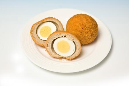 Scotch eggs on a blue studio background
